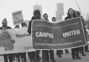 Carleton students and workers march in support of their colleagues in campus safety March 14.  Credit: Filip Szymanski